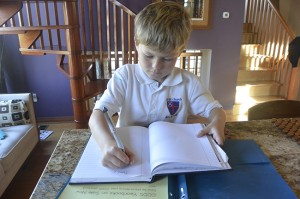 Christ Church kindergartner Teddy Kent begins his homework.
