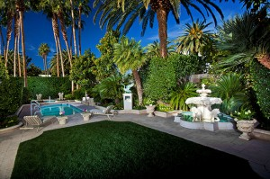 The Villas at The Mirage include a formal living/dining area (left) a private backyard with pool and putting green (above) and a  spacious master bedroom (top).