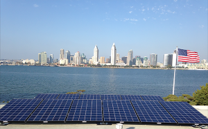 The sun's rays dance on San Diego Bay and, via the solar installation atop the roof of this First Street home, they are converted into energy.
