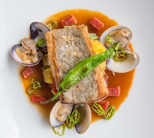 Local golden spotted bass with by spaghetti squash, tomatoes, shishito peppers and chorizo-clam broth