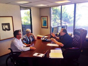 Charles Hayes (right) and John Hart of Hayes and Associates provide investment advice to their client, Carolyn Crane.