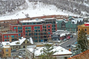 SkyLodge features luxury accommodations, including a three-bedroom penthouse, on Main Street. How close is it to the lifts? Notice the cables in the foreground.