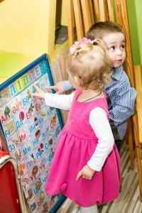 Two Kids In Montessori Preschool Class. Little Girl And Boy Play