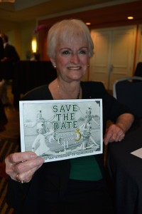 Jeanne Bowers holds a flyer showing her as a cheerleader from the 1950s.