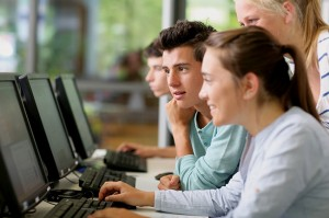 bigstock-Students-in-class-working-on-d-48265589