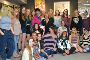 Appreciative students from Coronado High School surround Art & Frames owner Jill Hardman as she bestows an annual gift to the Coronado High School art department. Accepting is art teacher Laura Hill.