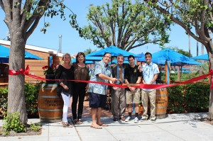 Mayor Casey Tanaka cut the ribbon at the Spiro's Greek Cafe grand re-opening ceremony on July 22, following a three-month remodel. Pictured from left: Robyn Gray, Nancy Chaconas, Casey Tanaka, Spiro Chaconas, Michael Chaconas and Demetri Chaconas.