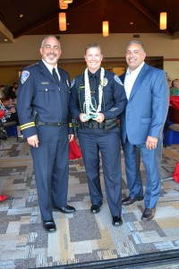 Police Chief Jon Froomin, Sherri Mannello, Police Officer of the Year, and husband, Michael.
