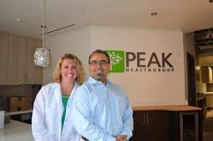 Susan Rinelander, nurse practitioner, and Dr. Patrick Yassini stand ready to welcome patients to the new Peak Health Group office.