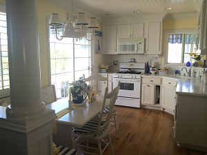 Boulanger created a coastal cottage feel with white cabinets in the kitchen.