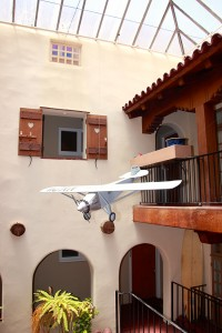 Aviator Charles Lindbergh called the Palomar Apartments home; a one-sixth scale replica of his plane, the Spirit of St. Louis soars over the apartment's atrium.