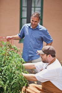 Right: Spatafore and chef de cuisine Colin Murray select herbs from the market's on-site garden; the market's Mess Hall restaurant
