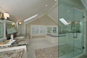 The Tudor home remodel transformed the third-story bathroom into a luxurious retreat with spa tub, skylights and spacious shower.