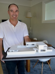 Christian Rice holds a model of his home now under construction at Seventh and Alameda. The contemporary home will feature a central courtyard.