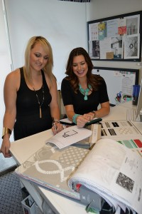 Amy McKnight and Jessica Tompane collaborate on a client's plans