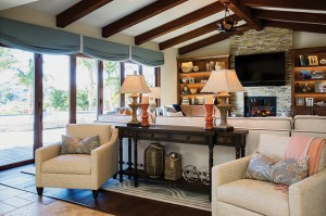 This great room design by J Hill Interiors features accordian (folding) doors, a popular trend in Coronado and Southern California, where homeowners want to enjoy an indoor/outdoor lifestyle.
