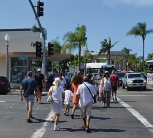 Summer crowds cross Tenth Street at Orange Avenue.