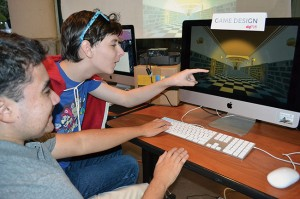 Luke Buckley, a junior, and Nicholas Olmo, a senior, are specializing in game design, one of the four divisions of CoSA's Digital Arts Conservatory.