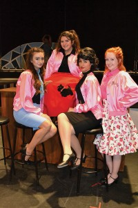 """The Pink Ladies"" of CoSA's fall musical Grease included, from left, Madison Hansmeyer, Briana Sanchez, Alana Schick, and Makaela Glancy, 