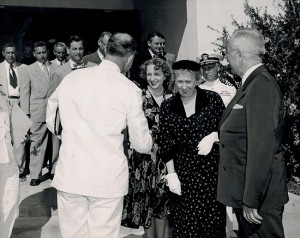 The president shakes hand with Chaplain Harold Menges; President Truman, his wife, Bess, and daughter Margaret greet Chaplain Menges after Sunday services.