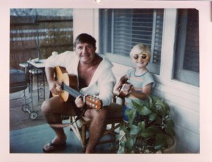 Matt Heinecke, shown here at age 5, has fond memories of strumming away on the guitar with his father, Walt.