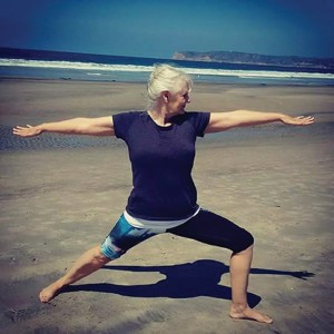 Dee Sloan, who teaches gentle somatic yoga at Adult Ed at Coronado High School, demonstrates the classic Warrior pose.