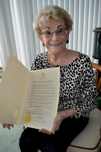 "Irma Dayton holds a City of Coronado proclamation signed by Mayor Richard Bailey, declaring Feb. 17, 2017 ""Irma Dayton Day"" in the City of Coronado."