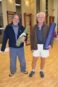 "Murray Nies (left) turned to yoga to develop more agility. ""But I've grown to love the meditation aspect of it, too,"" he said, while Sandy Knapp (right) began practicing yoga about nine years ago to stay limber. ""It virtually eliminated my back problems,"" he said."